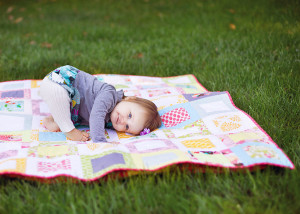 beautiful baby on homemade quilt