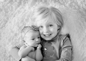 big sister little sister newborn photos