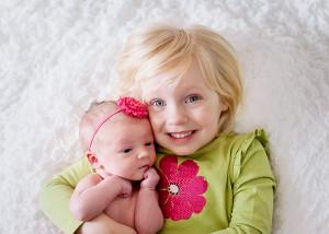 big sister and newborn girl kalamazoo
