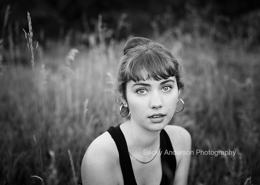 Beautiful senior portrait in a field