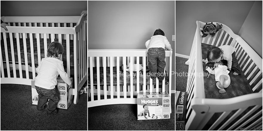 Big brother climbing crib to visit newborn sister